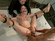 Impudent guys team up to roughly assfuck tied up bitch who is covered in wax