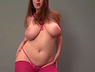 Babe in red stockings acts so dirty baring big natural twins and sexy butt and dancing on camera