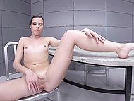 Girl isn't going to testify and masturbates pussy sitting on the chair in interrogation room