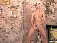 Tanned hottie Ornella Morgan from Czech satisfies shaved pussy with dildo in pub