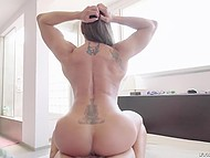 Muscled bitch with tattoos on the back is in no way inferior in sexual hunger to her partner