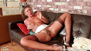 Mature French in high heels laid down on black couch and diligently masturbated hairy hole