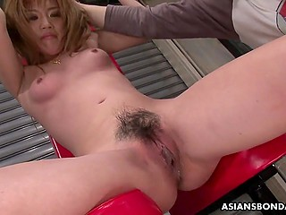 Two perverts humiliate helpless Japanese girl by massaging her dripping wet snatch with sex toys