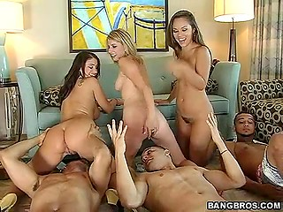 Three alluring bitches sit on fuckers' faces to warm themselves before group sex