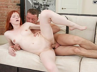 Pale-skinned redhead allows tanned guy to bang her for the glory of god of orgasm