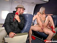 MILF goes crazy about cock on plane cause she is stewardess and passengers can see her humping