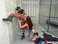 Homeless girl makes Ebony policewoman break Code of Ethics and satisfies her pussy in cell