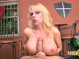 Blonde cougar with exceptional breasts strokes partner's fuckstick until he is ready to fill glass with jizz