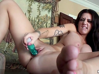 Possessor of big titties is so excited that she is ready to masturbate pussy with vibrator nonstop