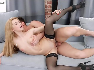 Man went crazy seeing small tits of blonde girlfriend in stockings and fucked her on the couch