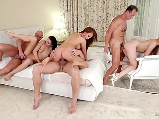 Alexis Crystal and her man lure two swinger couples into fantastic group sex in the living room