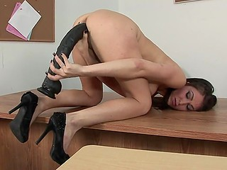 Long-legged minx stays after classes in the empty room to stretch excited vagina with sex toys