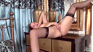 Miss Becky Perry undresses leaving just stockings and red shoes then she proceeds to masturbate