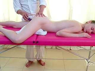 Naked girl receives more pleasure when the masseur brings a vibrator into play