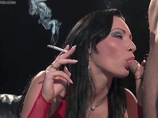 Heavy smoker with big breasts doesn't stop enjoying cigarettes even during copulation
