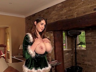 Attractive British bombshell in sexy Christmas outfit Bella Brewer shows photographer her melons
