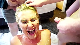 Amateur blonde with glasses and natural boobs happily culminates group sex with massive bukkake