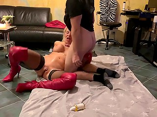 Hooker in stockings and red boots is so focused on sex that she doesn't notice the camera filming her