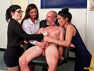 Office employees find out that boss jerks off watching porn and decide to stroke his cock with hands